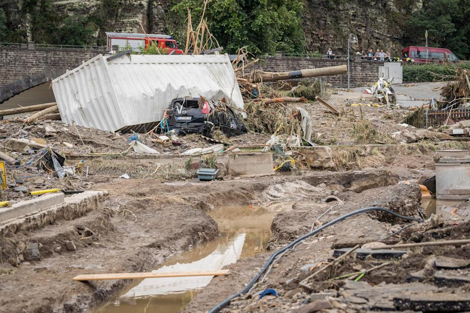 A destroyed car lies under a container amid debris following important floods in Schuld near Bad Neuenahr, western Germany.