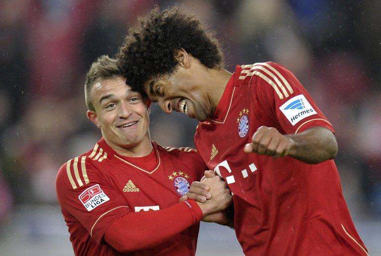 Bayern Munich defender Dante (R) and midfielder Xherdan Shaqiri celebrate after the game against Stuttgart, on January 27, 2013. Bayern have few injury problems for the Friday trip to Wolfsburg with Javi Martinez out with a bruised big toe, as is back-up striker Claudio Pizarro (throat infection), but Dante (stomach problems) should be fit
