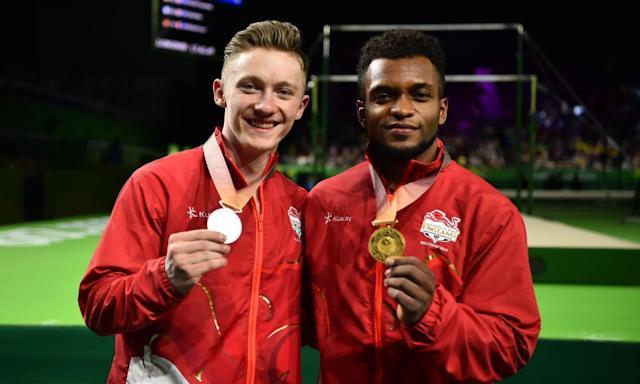 "<span class=""element-image__caption"">Silver medallist Nile Wilson (left) and gold medallist Courtney Tulloch following the gymnastics men's rings final at the Commonwealth Games.</span> <span class=""element-image__credit"">Photograph: Dan Mullan/Getty Images</span>"