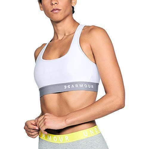 """<p><strong>Under Armour</strong></p><p>amazon.com</p><p><strong>$26.99</strong></p><p><a href=""""https://www.amazon.com/dp/B071S2KN98?tag=syn-yahoo-20&ascsubtag=%5Bartid%7C2142.g.36364738%5Bsrc%7Cyahoo-us"""" rel=""""nofollow noopener"""" target=""""_blank"""" data-ylk=""""slk:Shop Now"""" class=""""link rapid-noclick-resp"""">Shop Now</a></p><p>This mid-impact bra is lightweight but has a snug, compression fit that'll keep you comfy and protected on your fastest workouts. PS: This comes in more than 20 different colors. </p><p><em>[<a href=""""https://www.runnersworld.com/gear/g21603853/high-impact-sports-bras/"""" rel=""""nofollow noopener"""" target=""""_blank"""" data-ylk=""""slk:The Best High-Impact Bras"""" class=""""link rapid-noclick-resp"""">The Best High-Impact Bras</a>]</em></p>"""