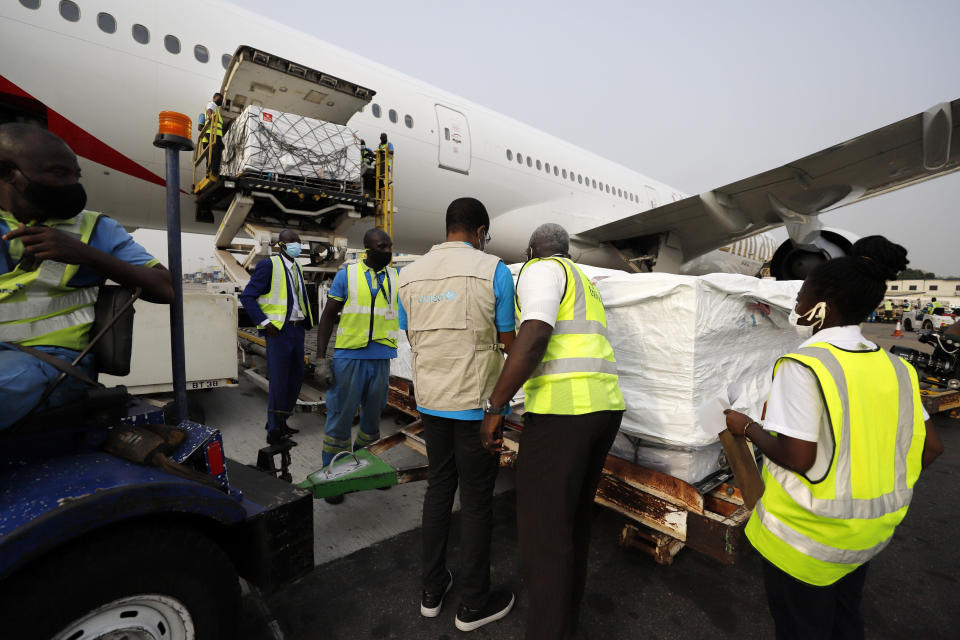 This photograph released by UNICEF Wednesday Feb. 24, 2021 shows the first shipment of COVID-19 vaccines distributed by the COVAX Facility arriving at the Kotoka International Airport in Accra, Ghana. As the coronavirus pandemic exploded worldwide last April, global organizations banded together to help ensure vaccines would be distributed fairly. But the COVAX initiative has been dogged by shortages of cash and supplies as well as logistical hurdles, and only on Wednesday did the first vaccines bought by program arrive in Ghana. (Francis Kokoroko/UNICEF via AP)