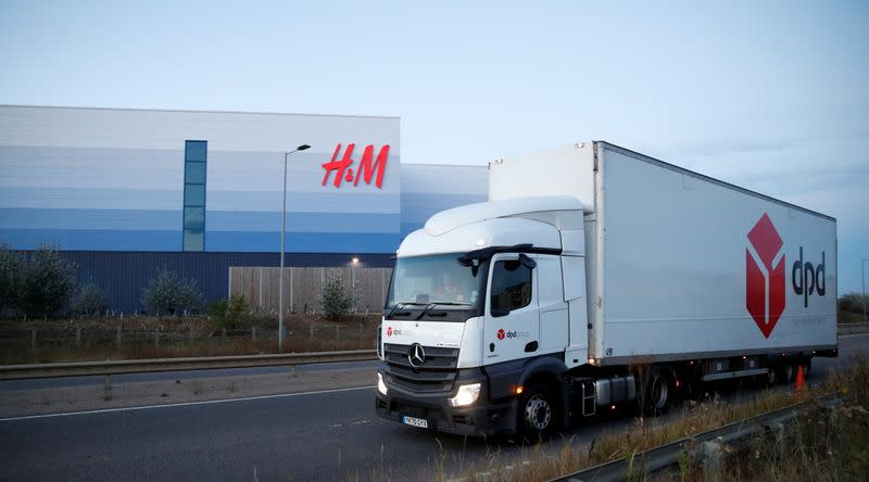 A DPD lorry drives past an H&M warehouse at Magna Park in Milton Keynes