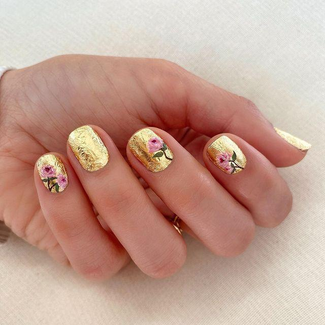 "<p>Instead of coating your nails in polish and adding a few pieces of <a href=""https://www.amazon.com/AIFAIFA-Metallic-Transfer-Sticker-Silver/dp/B07PRRF881/?tag=syn-yahoo-20&ascsubtag=%5Bartid%7C10049.g.34319849%5Bsrc%7Cyahoo-us"" rel=""nofollow noopener"" target=""_blank"" data-ylk=""slk:gold transfer foil"" class=""link rapid-noclick-resp"">gold transfer foil</a> on top, here's an idea: do the opposite of that. For this look, cover your nails completely in foil, then use polish and a super-thin <a href=""https://www.amazon.com/Brushes-Gel-Painting-application-Rhinestone/dp/B082KGB4XN/?tag=syn-yahoo-20&ascsubtag=%5Bartid%7C10049.g.34319849%5Bsrc%7Cyahoo-us"" rel=""nofollow noopener"" target=""_blank"" data-ylk=""slk:striping brush"" class=""link rapid-noclick-resp"">striping brush</a> to paint little flowers or whatever you feel like on top.</p><p><a href=""https://www.instagram.com/p/B9Wgyklg6oT/?utm_source=ig_embed&utm_campaign=loading"" rel=""nofollow noopener"" target=""_blank"" data-ylk=""slk:See the original post on Instagram"" class=""link rapid-noclick-resp"">See the original post on Instagram</a></p>"