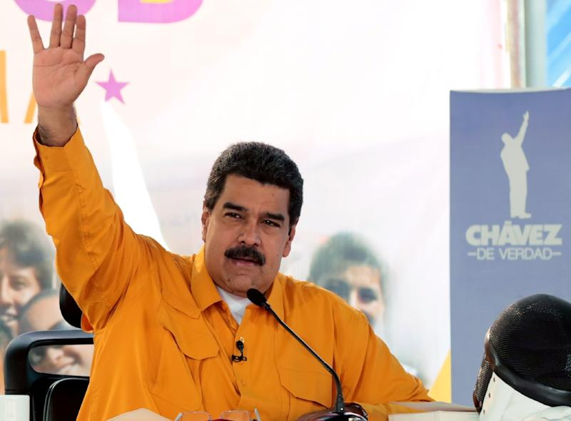 Various opponents of Venezuelan President Nicolas Maduro went to the court on Friday to try to add their names to the list of plaintiffs in a lawsuit, but found the tribunal closed and blocked by riot police vans (AFP Photo/Juan BARRETO)