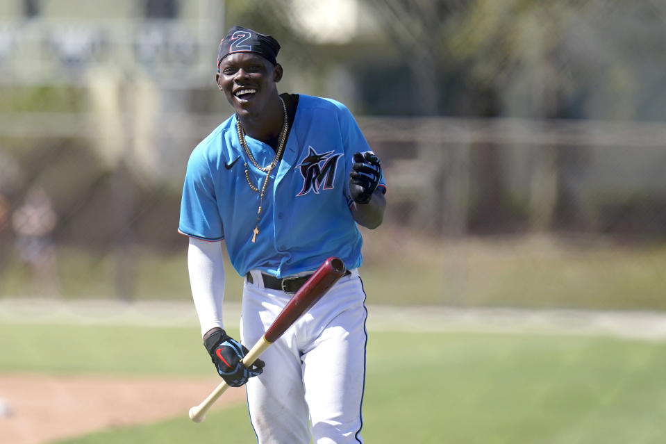 FILE - Miami Marlins' Jazz Chisholm laughs during spring training baseball practice in Jupiter, Fla., in this Friday, Feb. 26, 2021, file photo. For the Jeter regime, instant success hasn't happened at all. Four of the Marlins' top 12 prospects made their MLB debuts last year, and none batted above .170.(AP Photo/Jeff Roberson)