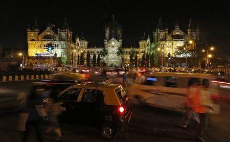 Heavy traffic moves in front of the Chhatrapati Shivaji terminus railway station before Earth Hour in Mumbai