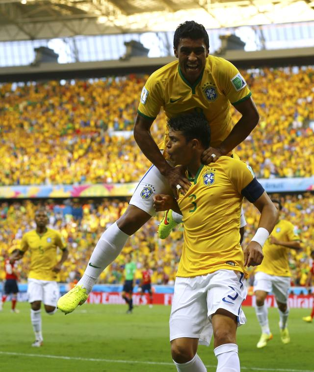 Brazil's Thiago Silva (3) celebrates with Paulinho after scoring a goal during the 2014 World Cup quarter-finals between Brazil and Colombia at the Castelao arena in Fortaleza July 4, 2014. REUTERS/Marcelo Del Pozo (BRAZIL - Tags: TPX IMAGES OF THE DAY SOCCER SPORT WORLD CUP)
