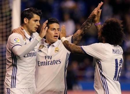 Football Soccer- Spanish La Liga Santander - Deportivo v Real Madrid - Riazor stadium, A Coruna, Spain - 26/04/17 Real Madrid's James Rodriguez (C) celebrates a goal with team mate Alvaro Morata (L) and Marcelo. REUTERS/Miguel Vidal