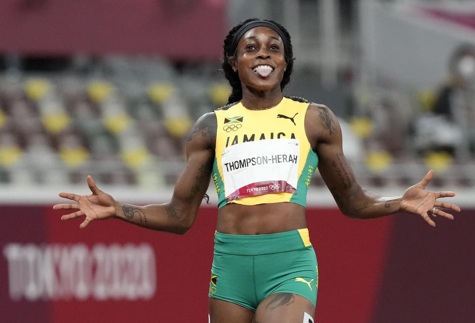 Elaine Thompson-Herah, of Jamaica celebrates after winning the gold medal in the final of the women's 200-meter at the 2020 Summer Olympics, Tuesday, Aug. 3, 2021, in Tokyo, Japan. (AP Photo/Martin Meissner)