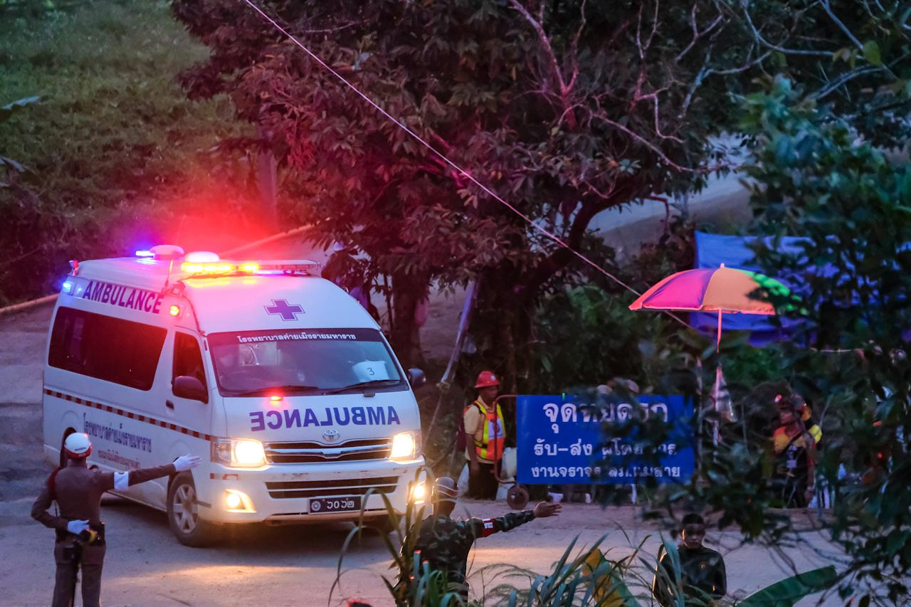 <p>Two ambulances carrying the sixth & seventh boys out of Tham Luang Nang Non cave site continuously to a hospital in Chiang Rai on July 9, 2018 in Chiang Rai, Thailand. Divers began an effort to pull the 12 boys and their soccer coach on Sunday morning after they were found alive in the cave at northern Thailand. Videos released by the Thai Navy SEAL shows the boys, aged 11 to 16, and their 25-year-old coach are in good health in Tham Luang Nang Non cave and the challenge now will be to extract the party safely. (Photo: Linh Pham/Getty Images) </p>