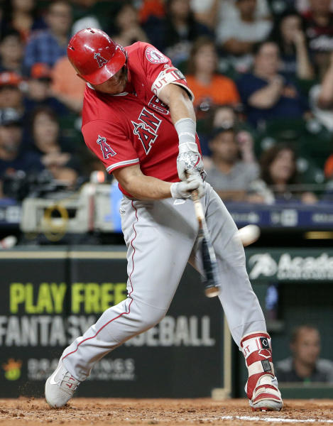 Los Angeles Angels' Mike Trout connects for a three run home run during the eighth inning of a baseball game against the Houston Astros, Saturday, Sept. 22, 2018, in Houston. (AP Photo/Michael Wyke)