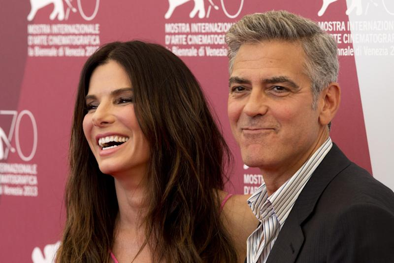 Actors Sandra Bullock and George Clooney poses for photographers at the photo call for the film Gravity during the 70th edition of the Venice Film Festival held from Aug. 28 through Sept. 7, in Venice, Italy, Wednesday, Aug. 28, 2013. (AP Photo/David Azia)
