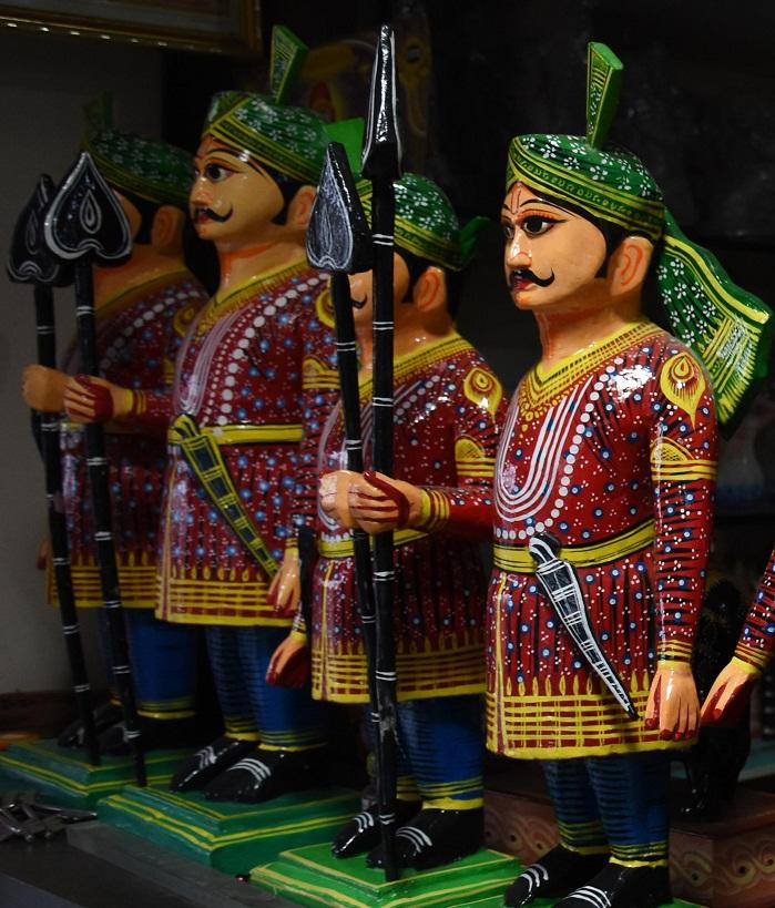 Kondapalli toys are made from soft wood known as Tella Poniki which are found in nearby Kondapalli Hills