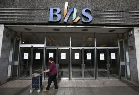 A woman walks past the Wood Green branch of department store chain BHS after its final closure in London
