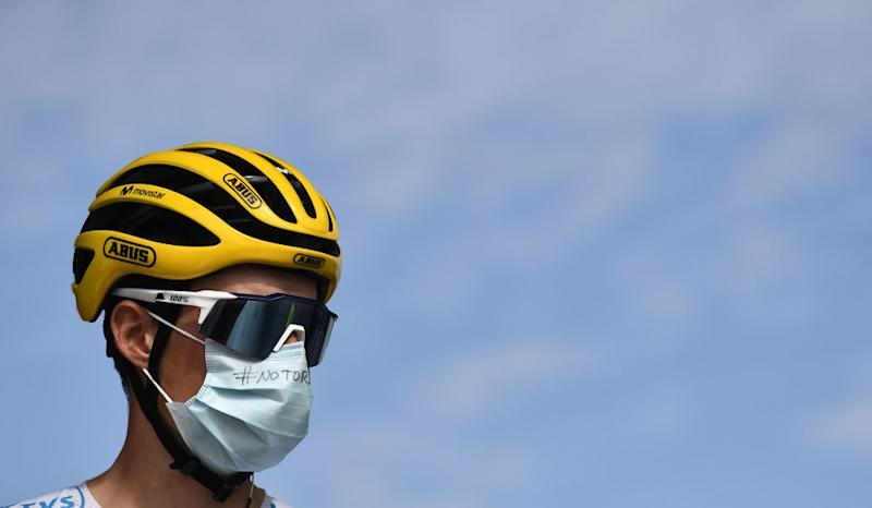 Team Movistar rider Spains Enric Mas wearing the best youngs white jersey waits prior to the 21st and last stage of the 107th edition of the Tour de France cycling race 122 km between ManteslaJolie and Champs Elysees Paris on September 20 2020 Photo by Marco Bertorello POOL AFP Photo by MARCO BERTORELLOPOOLAFP via Getty Images