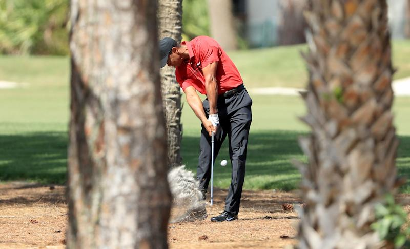 PALM BEACH GARDENS, FL - FEBRUARY 25: Tiger Woods of the United States plays his second shot on the par 5, third hole during the final round of the 2018 Honda Classic on The Champions Course at PGA National Resort on February 25, 2018 in Palm Beach Gardens, Florida. (Photo by David Cannon/Getty Images)