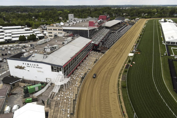 The first turn is seen at Pimlico Race Course ahead of the Preakness Stakes horse race, Tuesday, May 11, 2021, in Baltimore. (AP Photo/Julio Cortez)