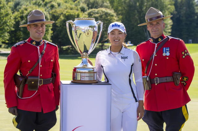 Jin Young Ko of South Korea poses with the trophy after winning the CP Women's Open in Aurora, Ontario, Sunday, Aug. 25, 2019. (Frank Gunn/The Canadian Press via AP)