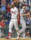 Philadelphia Phillies' Bryce Harper (3) shouts at home plate after hitting an inside-the-park home run during the fifth inning of the team's baseball game against the Washington Nationals, Tuesday, July 27, 2021, in Philadelphia. (AP Photo/Laurence Kesterson)