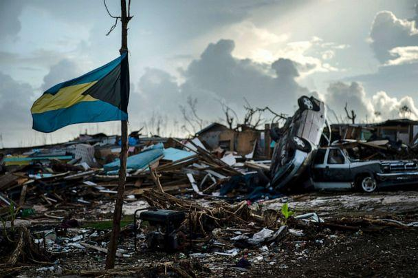 PHOTO: A Bahamas flag flies amidst the rubble left by Hurricane Dorian in Abaco, Bahamas, Sept. 16, 2019. Dorian hit the northern Bahamas on Sept. 1, with sustained winds of 185 mph, unleashing flooding that reached 25 feet in some areas. (Ramon Espinosa/AP)