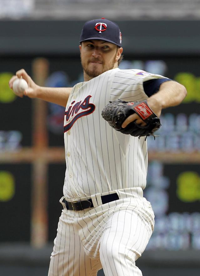 Minnesota Twins pitcher Phil Hughes delivers to the Detroit Tigers during the fourth inning of a baseball game in Minneapolis, Saturday, April 26, 2014. (AP Photo/Ann Heisenfelt)