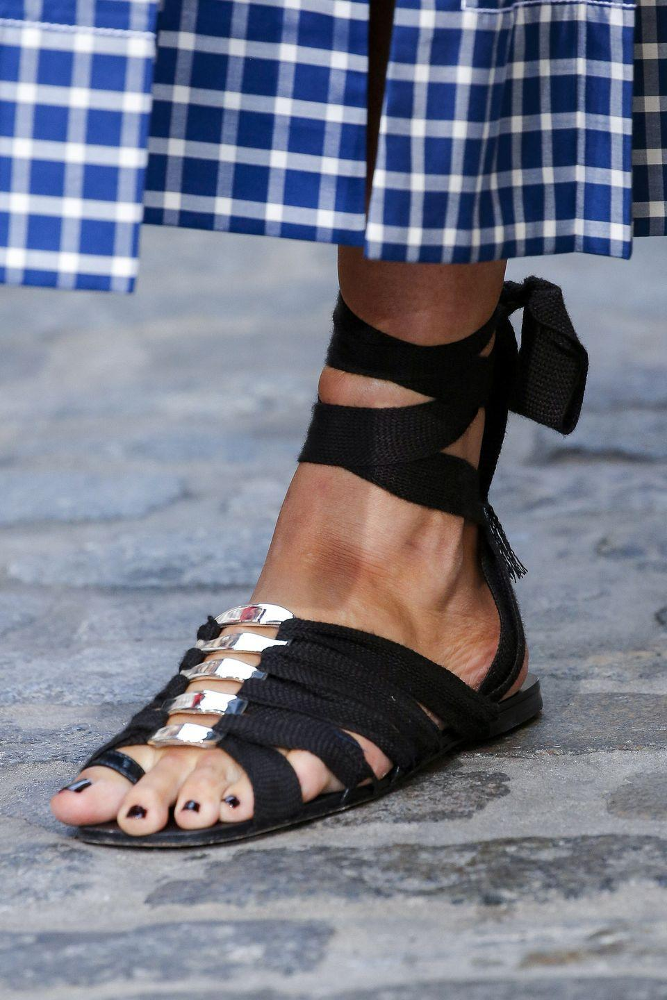 <p>Taking the flossing trend to the next level, Tory Burch also served up strappy, lace-up sandals on its spring catwalk.</p>