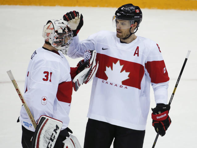 Canada defenseman Shea Weber congratulates Canada goaltender Carey Price after Canada defeated Latvia 2-1in a men's quarterfinal ice hockey game at the 2014 Winter Olympics, Wednesday, Feb. 19, 2014, in Sochi, Russia. (AP Photo/Mark Humphrey)