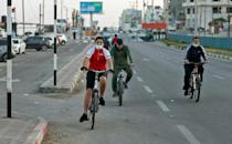 Palestinians ride their bicycles in Gaza City, as another way to shake off the stresses of being cooped up in the enclave during the coronavirus pandemic