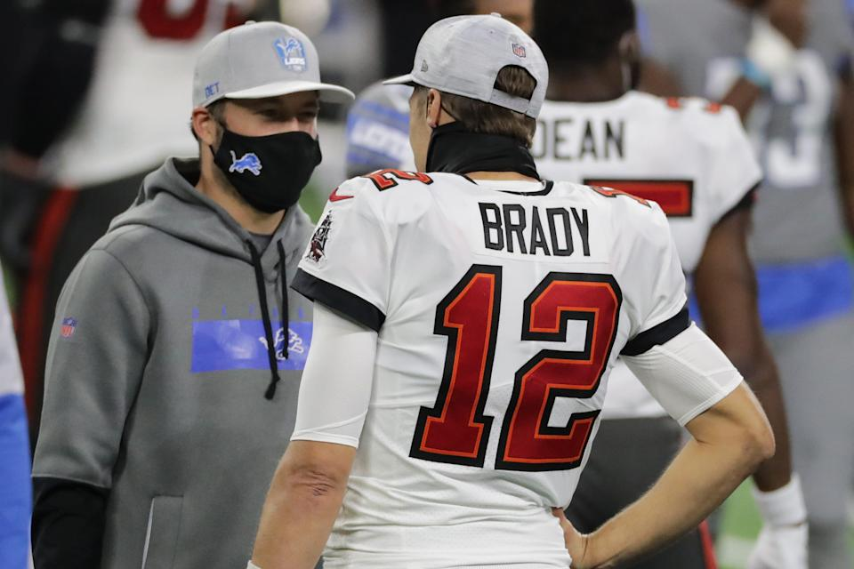 Detroit Lions quarterback Matthew Stafford and Tampa Bay Buccaneers quarterback Tom Brady chat after the Lions' 47-7 loss at Ford Field, Dec. 26, 2020.