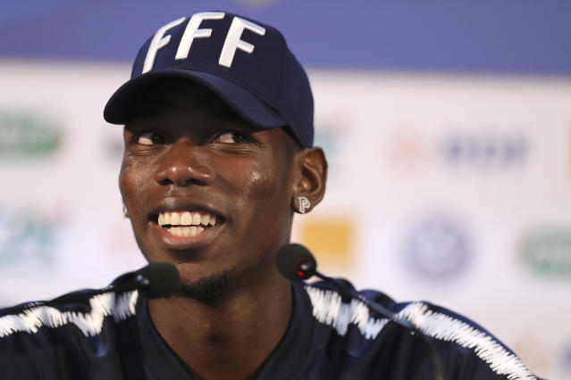 France's Paul Pogba gestures as he answers journalists during a press conference at the 2018 soccer World Cup in Istra, Russia, Sunday, June 24, 2018. (AP Photo/David Vincent)