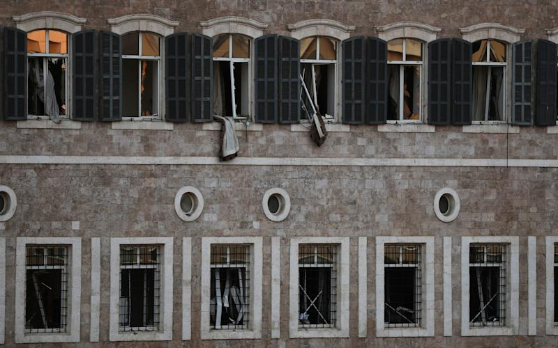The windows of Lebanon's Government Palace were blasted out - AP
