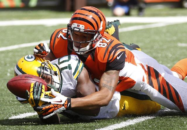 Green Bay Packers kick returner Jeremy Ross (10) fumbles a kickoff as he is hit by Cincinnati Bengals' Marvin Jones (82) in the first half of an NFL football game, Sunday, Sept. 22, 2013, in Cincinnati. The Bengals recovered the fumble. (AP Photo/David Kohl)