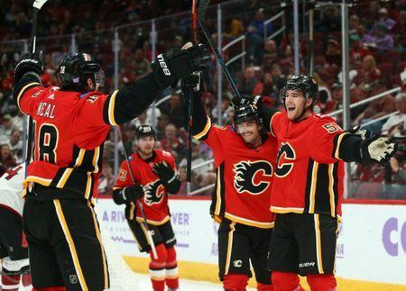 Nov 25, 2018; Glendale, AZ, USA; Calgary Flames defenseman Noah Hanifin (55) celebrates a goal with center Derek Ryan (10) and left wing James Neal (18) against the Arizona Coyotes in the second period at Gila River Arena. Mandatory Credit: Mark J. Rebilas-USA TODAY Sports