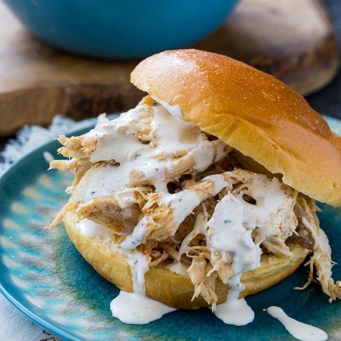 """<p><strong>Pulled Chicken with White Sauce Sandwich</strong></p><p>In the heart of barbecue country, Alabama is home to its whole smoked chickens and rare mayo-based white barbecue sauce. The chickens are smoked over hickory wood for three hours before being doused in tangy sauce, served on a toasted bun and topped with slaw. Try the original at <a href=""""https://bigbobgibson.com/"""" rel=""""nofollow noopener"""" target=""""_blank"""" data-ylk=""""slk:Big Bob Gibson's Bar-B-Q"""" class=""""link rapid-noclick-resp"""">Big Bob Gibson's Bar-B-Q</a> in Decatur.</p>"""
