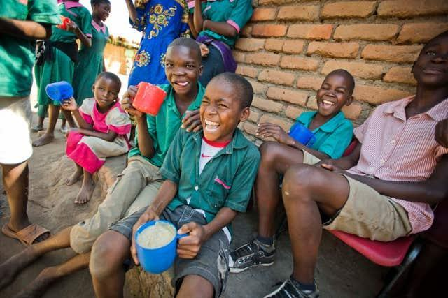 Children receiving a meal from Mary's Meals