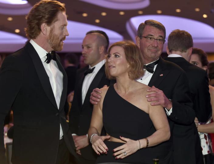 "<p>Defense Secretary Ash Carter, right, holds the shoulders of his wife, Stephanie, as she talks with ""Homeland"" actor Damian Lewis at the annual White House Correspondents' Dinner, April 30. <i>(Photo: Susan Walsh/AP)</i></p>"