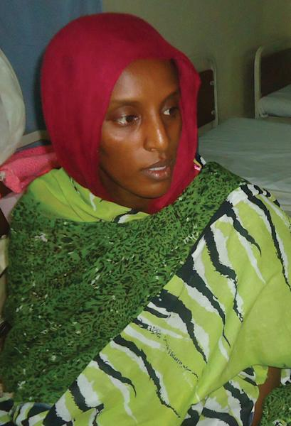 Sudanese Christian woman Meriam Yahia Ibrahim Ishag, who was sentenced to hang for apostasy but later acquitted, sits in her cell a day after she gave birth at a women's prison in Khartoum's twin city of Omdurman on May 28, 2014 (AFP Photo/)