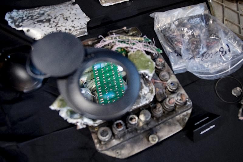 A magnifying glass shows a part of the guidance system to an Iranian Qiam Ballistic Missile alleged to have been fired at Saudi Arabia by Huthi forces in Yemen