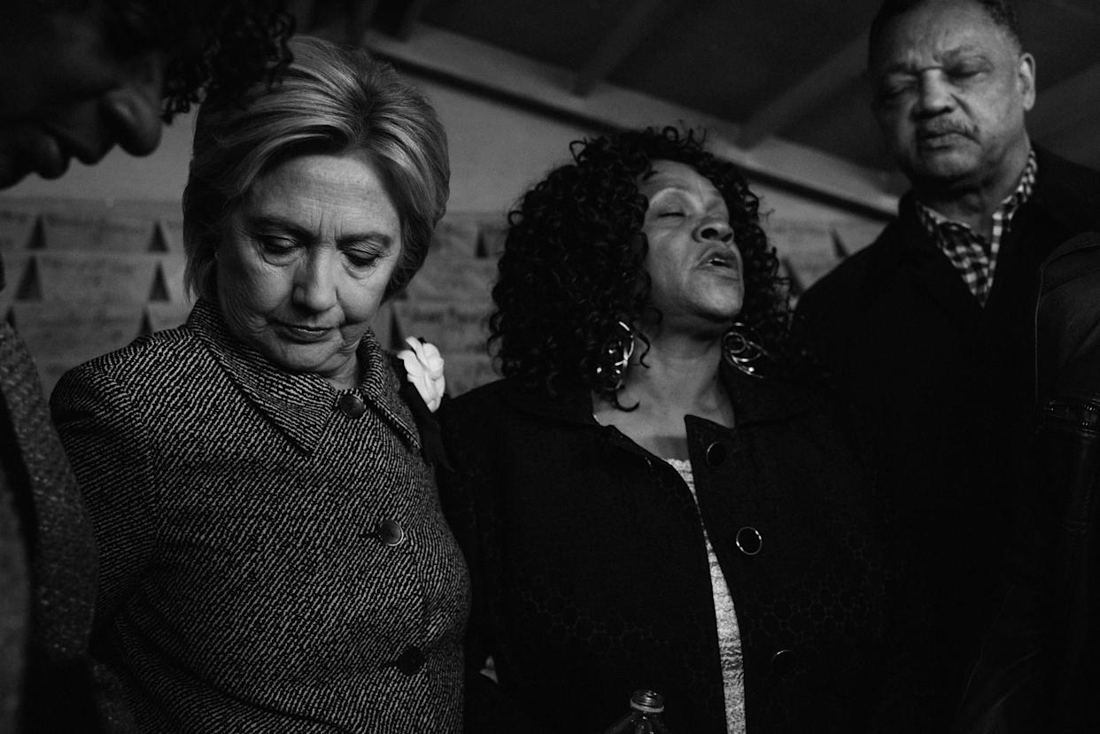 Hillary Clinton prays, accompanied by Reverend Jesse Jackson, Diane Latiker and mothers who have lost children to gun violence, visit the Kids Off the Block memorial in the Roseland neighborhood of Chicago in March 2016. (Photo: Melina Mara/The Washington Post via Getty Images)