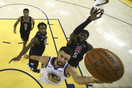 April 13, 2019; Oakland, CA, USA; Golden State Warriors guard Stephen Curry (30) shoots the basketball against LA Clippers forward Montrezl Harrell (5) during the first half in game one of the first round of the 2019 NBA Playoffs at Oracle Arena. Mandatory Credit: Ezra Shaw/Pool Photo via USA TODAY Sports