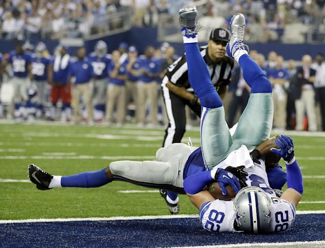 Dallas Cowboys tight end Jason Witten (82) makes a 4-yard touchdown reception as New York Giants safety Ryan Mundy (21) defends during the second half of a NFL football game Sunday, Sept. 8, 2013, in Arlington, Texas. (AP Photo/Tony Gutierrez)