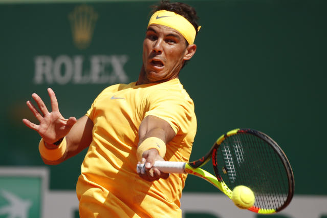 Spain's Rafael Nadal plays a shot against Japan's Kei Nishikori during the men's singles final match of the Monte Carlo Tennis Masters tournament in Monaco, Sunday April 22, 2018. (AP Photo/Christophe Ena)
