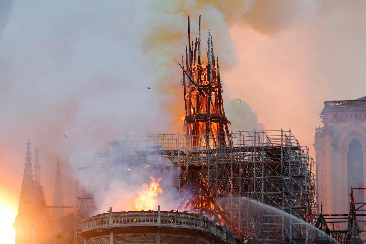 Smoke and flames rise during a fire at the landmark Notre-Dame Cathedral in central Paris on April 15, 2019, potentially involving renovation works being carried out at the site, the fire service said. (Photo: Francois Guillot/AFP/Getty Images)