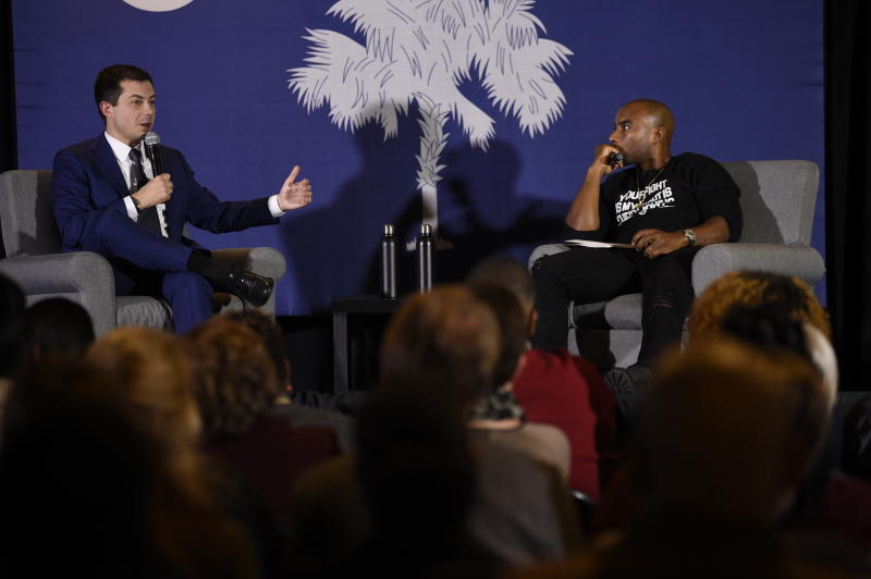 Democratic presidential contender and former South Bend, Indiana, Mayor Pete Buttigieg speaks with Charlamagne Tha God during an event on economic struggles in the black community on Thursday, Jan. 23, 2020, in Moncks Corner, S.C. (AP Photo/Meg Kinnard)