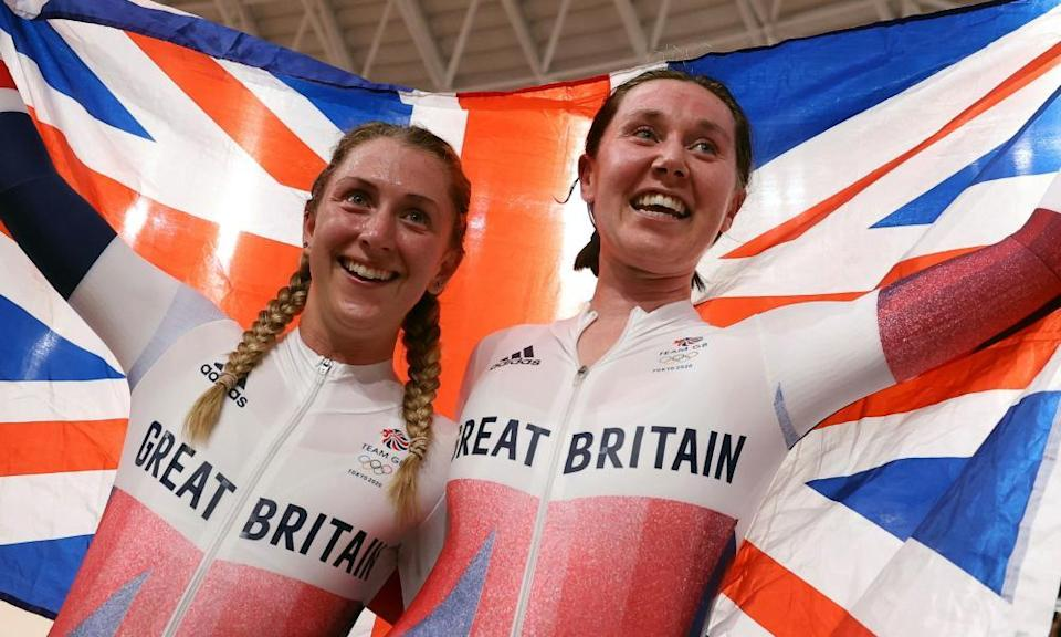 Laura Kenny and Katie Archibald celebrate winning gold.