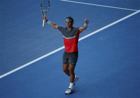 Rafael Nadal of Spain celebrates defeating Grigor Dimitrov of Bulgaria in their men's singles quarter-final tennis match at the Australian Open 2014 tennis tournament in Melbourne January 22, 2014. REUTERS/Jason Reed