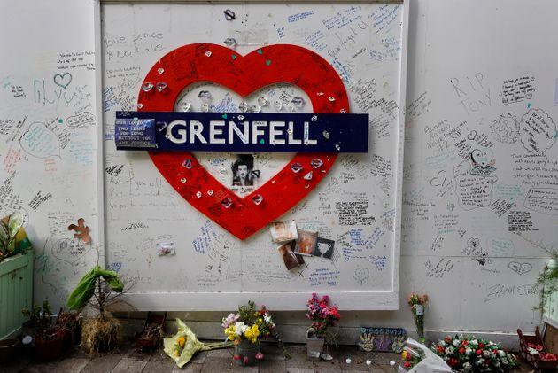 Tributes placed at the foot of Grenfell Tower, three years on from the disaster.