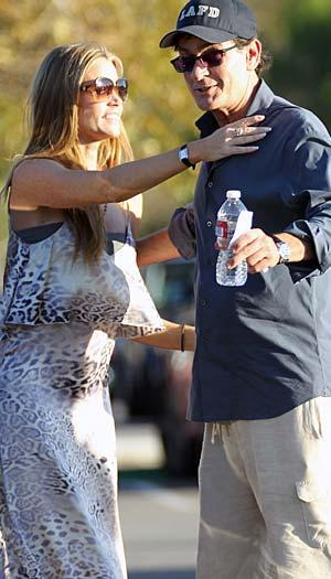 Denise Richards catches up with her ex, Charlie Sheen. (MAP/Splash News)