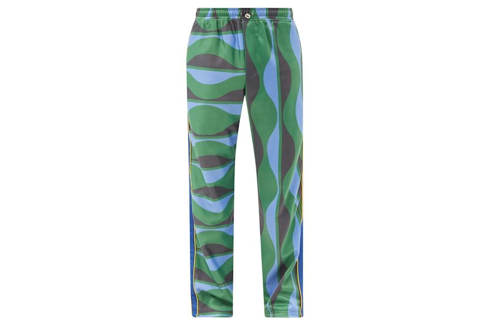 """$525, Matches Fashion. <a href=""""https://www.matchesfashion.com/us/products/Ahluwalia-Joy-wave-print-jersey-track-pants-1407978"""" rel=""""nofollow noopener"""" target=""""_blank"""" data-ylk=""""slk:Get it now!"""" class=""""link rapid-noclick-resp"""">Get it now!</a>"""