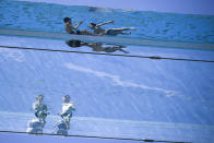 People swim in the Sky Pool, a transparent bridge across two exclusive residential blocks near the U.S. embassy in the Nine Elms area of London, on Tuesday, June 1, 2021. Britain sees temperatures increasing for the second day in a row after the mercury hit 25 degrees Celcius (77 degrees Fahrenheit) for the warmest day of the year so far on Bank Holiday Monday. (AP Photo/Alberto Pezzali)